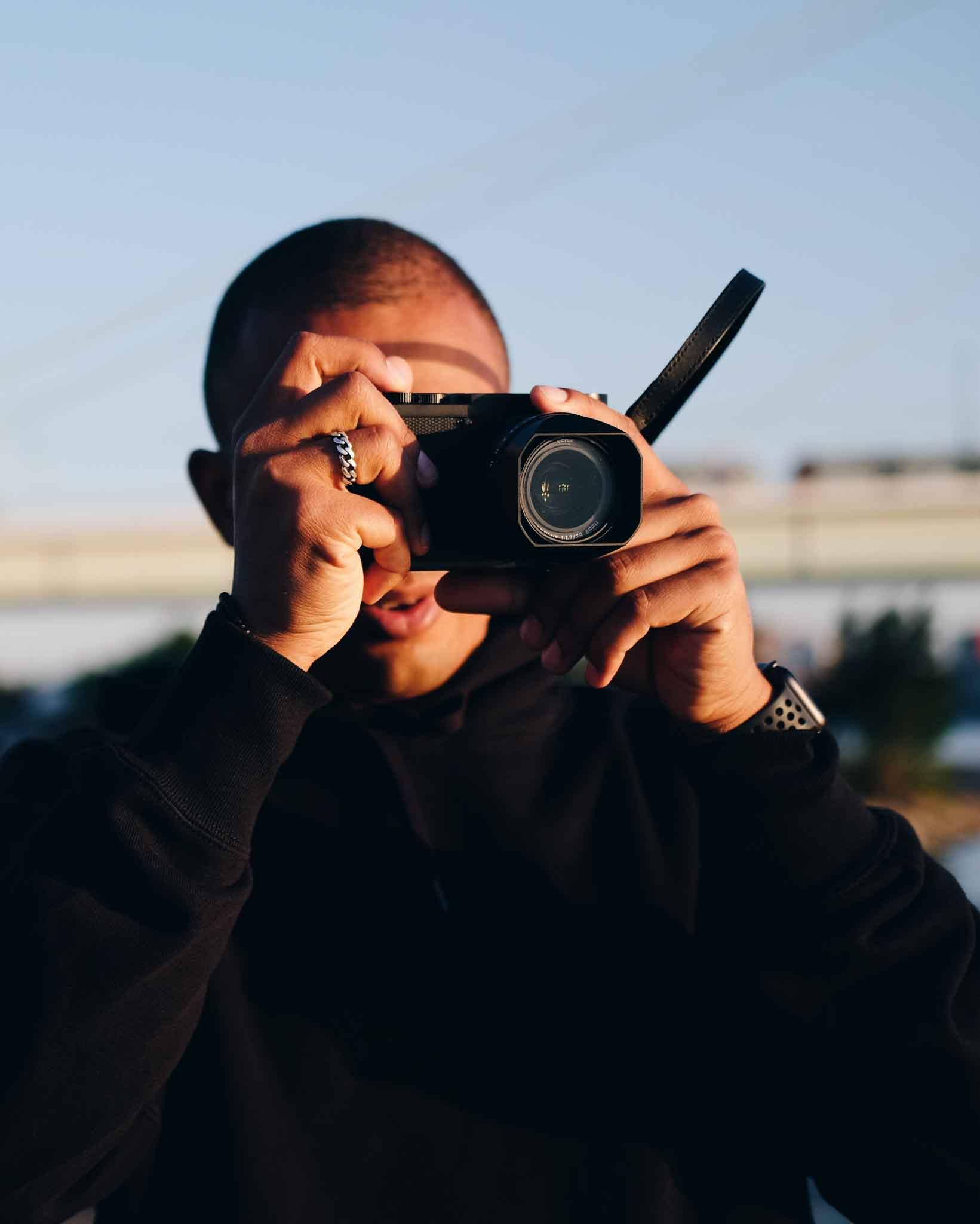 Salif Diallo holding a camera